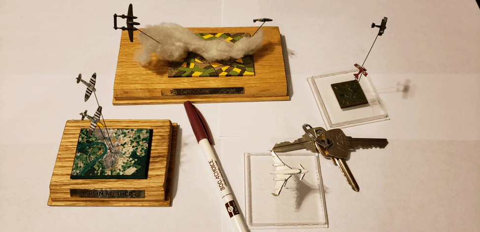 A few of Rumminger's 1/525th scale models, with pen and keys shown for scale.